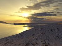 Sunset on stony beach